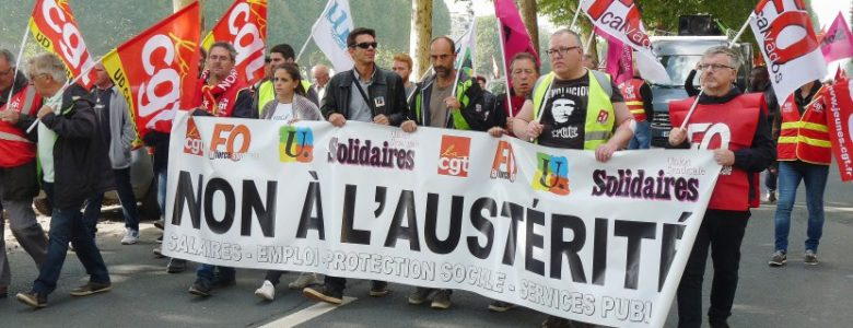 French workers protest Macron's labour reform – and the troika's arrival in Paris