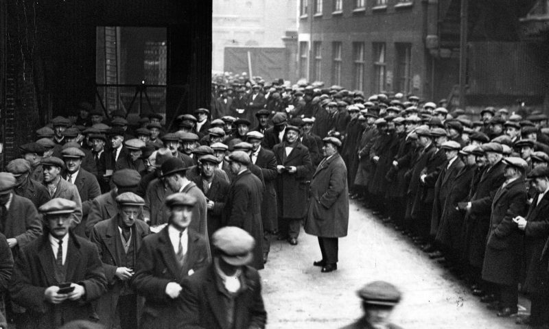 Labourers queue for work at the London docks in 1931. Photograph: Fox Photos/Getty Images