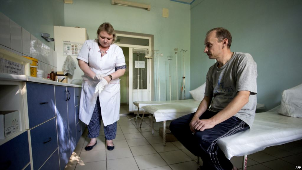 A patient waits to be treated in the toxicology unit in a hospital treating drug users in separatist-held Donetsk.